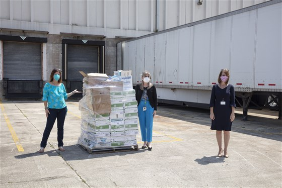 Rebecca Talaia, Ana Sanchez and Tina Descovich at Health First's Distribution Center delivering wipes donation