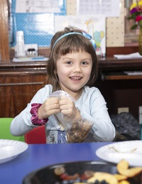 Pre-school Girl at Child Development Center table