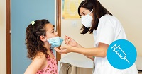 Female Nurse wearing a mask putting a mask on a female child in a providers office.