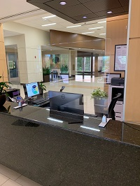 Empty desk in lobby with Plexiglass Partition