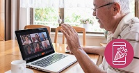 An older man on a laptop watching a group video chat.