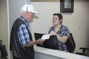 Registration associate checking in a patient