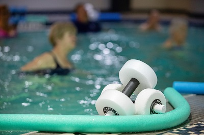 Swimmers in pool with aquacise equipment