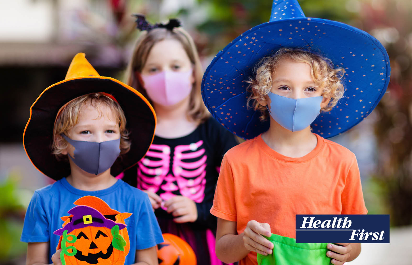 Children wearing halloween costumes and face masks