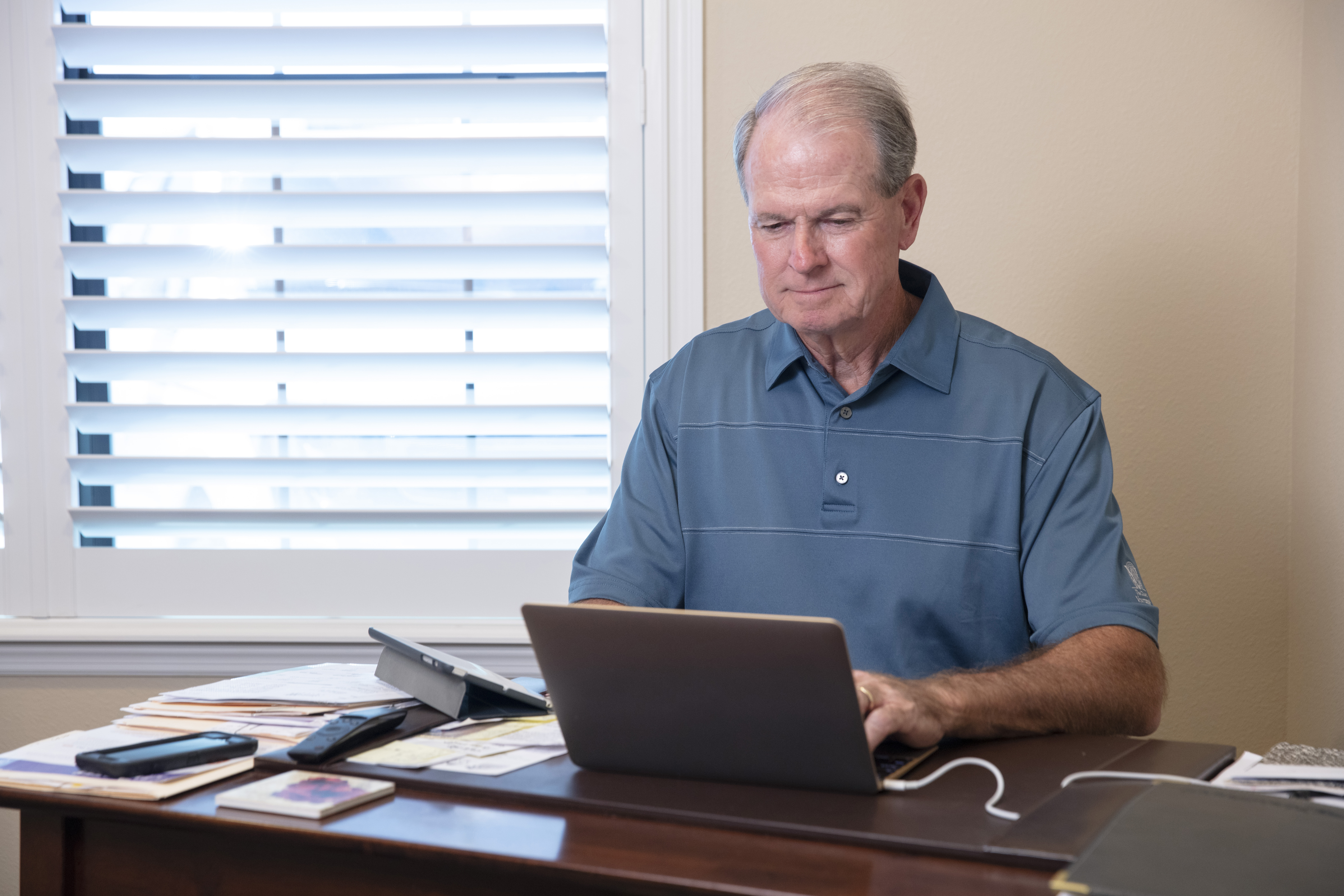 Man on laptop during a virtual visit.