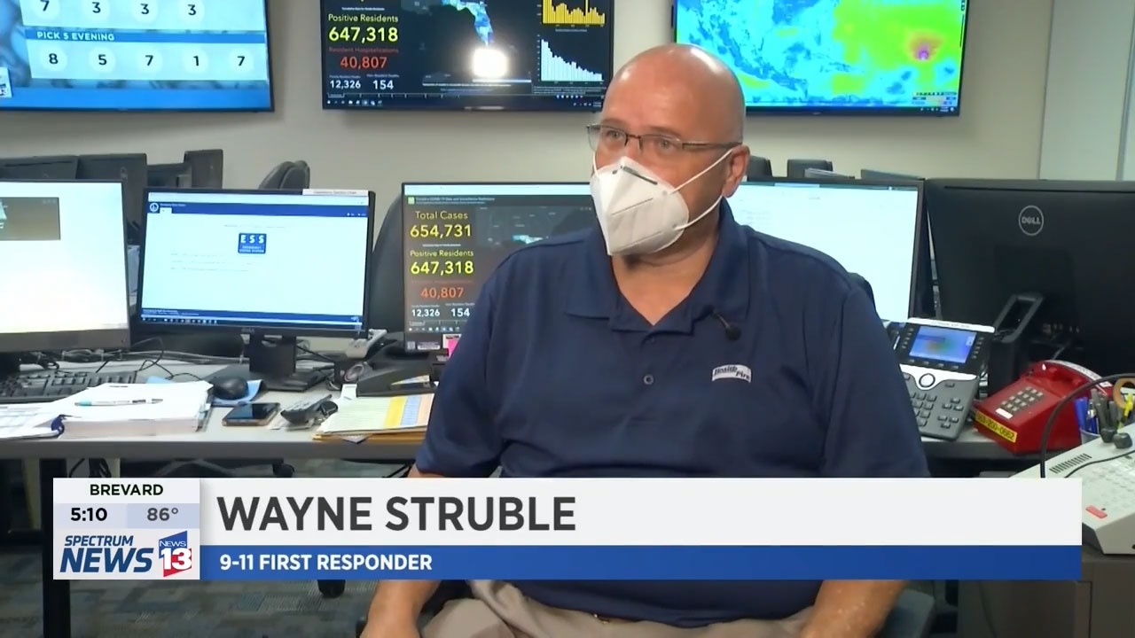 Emergency Management Director Wayne Struble wearing a facemask during an interview about his role in the 911 recovery efforts.