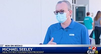 Michael Seeley, Health First Foundation President speaking wearing facemask on WESH 2 News report